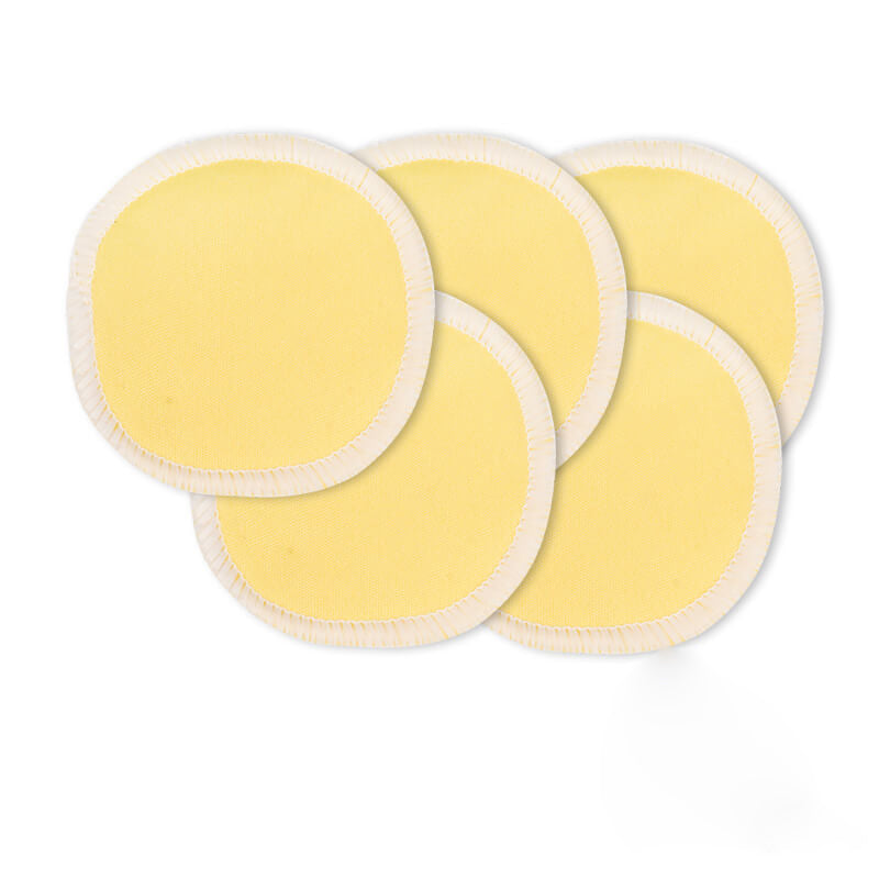 Reusable bamboo makeup remover pads in light yellow