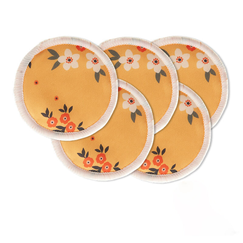 Reusable bamboo fiber makeup remover pads with flower print in yellow