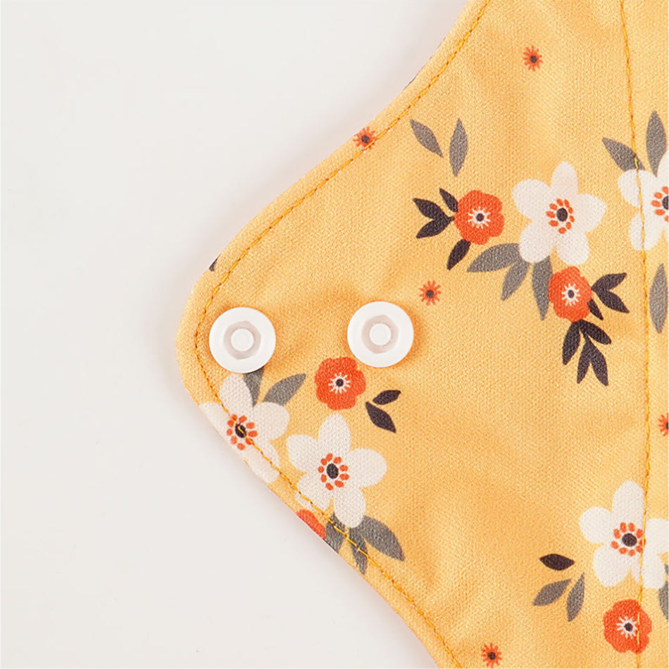 mora mona reusable sanitary cloth pad features 2 buttons on each wing
