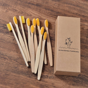 eco-friendly adult bamboo toothbrush in yellow color