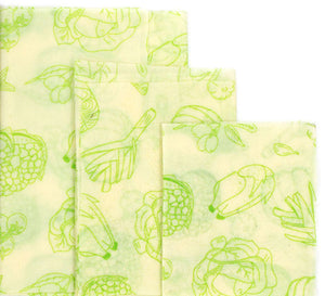 3 different sizes of reusable beeswax food wraps with vegetable pattern