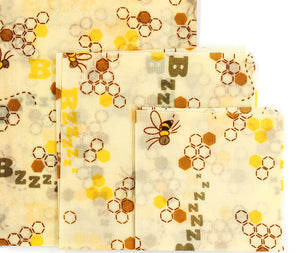 3 different sizes of reusable beeswax food wraps with bee pattern