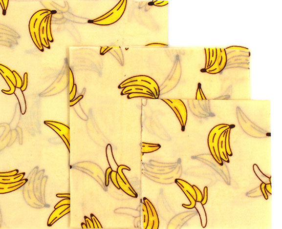 3 different sizes of reusable beeswax food wraps with banana pattern