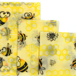 3 different sizes of reusable beeswax food wraps with bee & honeycomb pattern