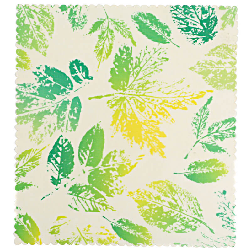 Reusable beeswax food wraps with green leavespattern
