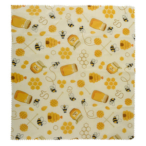 Reusable beeswax food wraps with honey pattern