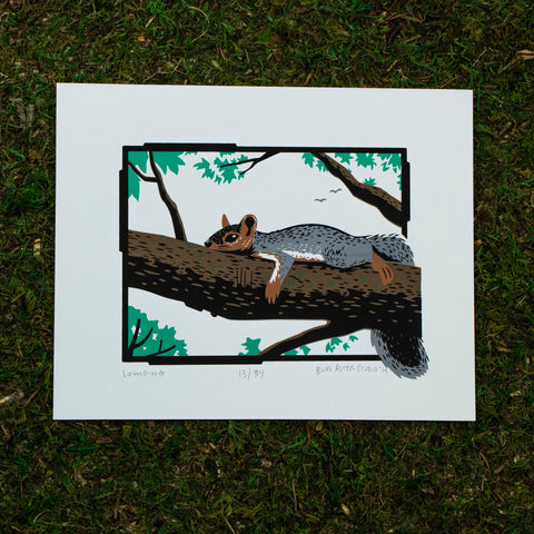 Screen print of a squirrel lounging on a tree branch.