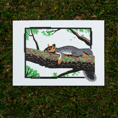 An art print of a squirrel lounging in a tree.