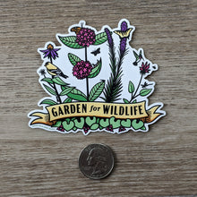 Load image into Gallery viewer, The Garden For Wildlife vinyl sticker sitting next to a USD quarter to show scale.