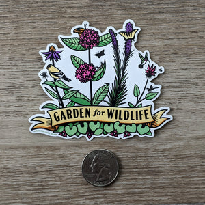 The Garden For Wildlife vinyl sticker sitting next to a USD quarter to show scale.