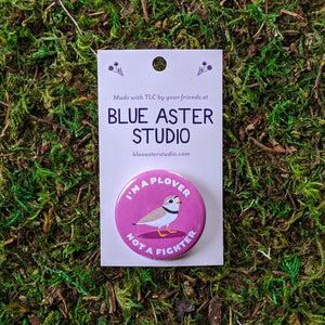 "A 1.5"" button with an illustration of a piping plover on a pink background with the words ""I'm A Plover Not A Fighter"""