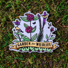 "Load image into Gallery viewer, A vinyl sticker with illustrations of plants such as milkweed, liatris, bee balm, and echinacea with critters all around them including birds, butterflies, and other insects. At the bottome of the sticker there is a banner that reads ""Garden For Wildlife"""