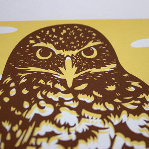 A close-up of the screen print showing just the detail of the burrowing owl's face.
