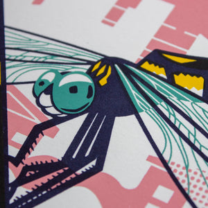 A close-up of the screen print showing the detail of the dragonfly.