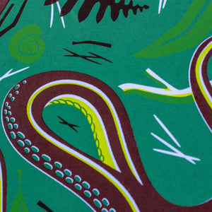 A close-up of the screen print showing the detail of the snake and the natural leaf litter that surrounds it.
