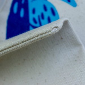 A close-up of the bottom seam on the tote bag.