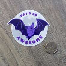 "Load image into Gallery viewer, A vinyl sticker of an illustrated cartoon bat flying in front of a full moon with the words ""Bat's So Awesome"""