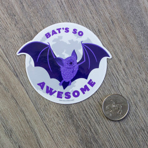 "A vinyl sticker of an illustrated cartoon bat flying in front of a full moon with the words ""Bat's So Awesome"""