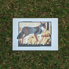 Load image into Gallery viewer, A 5x7 art print of a coyote in the underbrush of a woodland setting. Printed in grays, browns, and black.