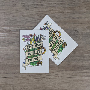 "A stack of postcards with the message ""Cherish Wild Things."""