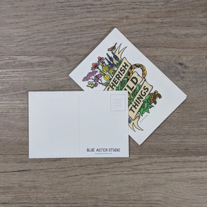 "A stack of ""Cherish Wild Things"" postcards with one flipped to the back to show the writing area, address area and Blue Aster Studio logo."