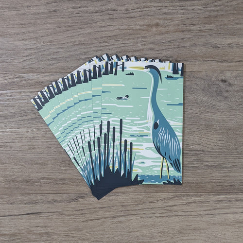 A stack of heron postcards fanned out.