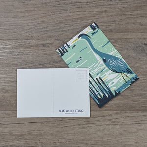 Set of ten great blue heron postcards with one flipped to show the message and address areas as well as the Blue Aster Studio logo.