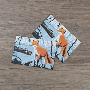 A stack of fox postcards with one leaning against the stack of cards.