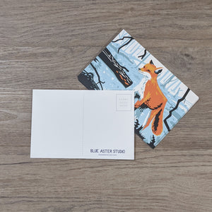 A stack of fox postcards with one flipped to show the back message and address areas as well as the Blue Aster Studio logo.