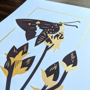 A close-up of the screen print showing the slight shine from the gold ink.