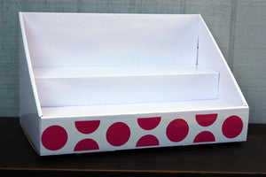 White Display with Pink Polka Dot Design