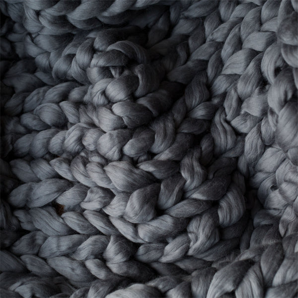 close-up gray chunky knitted blanket throw merino wool