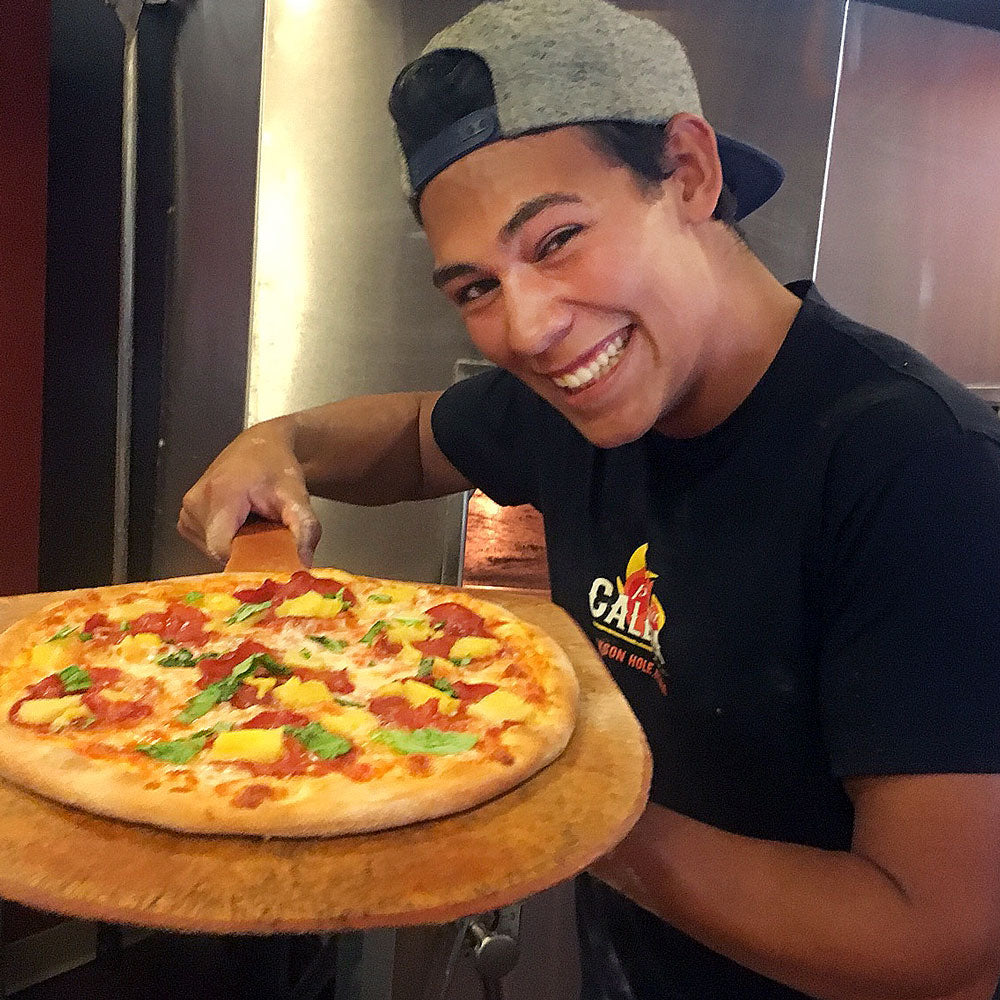 Diego serving up a great pizza