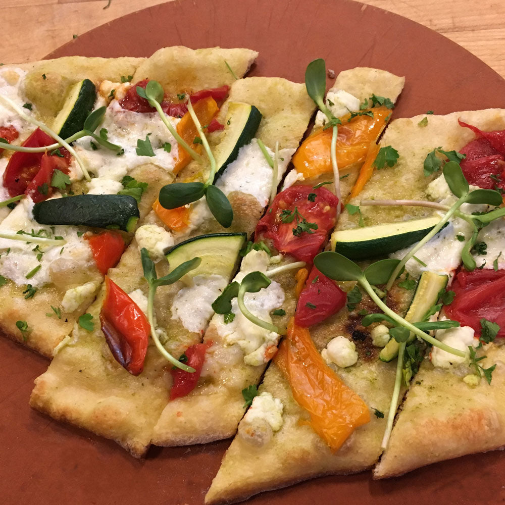 flat bread with goat cheese, vertical harvest micro greens, tomatoes and peppers