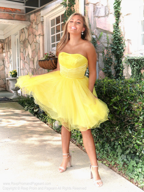 Model in a Simple and Elegant Yellow Homecoming Dress at Rsvp Prom and Pageant, the best prom dress store located in Atlanta, Georgia