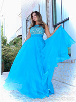 Pretty model in a sweet A-line gown has a beautifully beaded neckline and a rouched waistline over the full flowing chiffon skirt. And it's at Rsvp Prom and Pageant, your source of the HOTTEST Prom and Pageant Dresses and Exclusive Evening Gowns and located in Atlanta, Georgia!