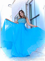 Brunette in a sweet A-line gown has a beautifully beaded neckline and a rouched waistline over the full flowing chiffon skirt. And it's at Rsvp Prom and Pageant, your source of the HOTTEST Prom and Pageant Dresses and Exclusive Evening Gowns and located in Atlanta, Georgia!