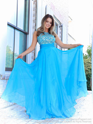 Model in a sweet A-line gown has a beautifully beaded neckline and a rouched waistline over the full flowing chiffon skirt. And it's at Rsvp Prom and Pageant, your source of the HOTTEST Prom and Pageant Dresses and Exclusive Evening Gowns and located in Atlanta, Georgia!