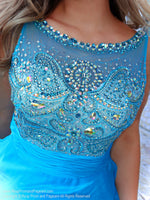 Up close of Brunette in a sweet A-line gown has a beautifully beaded neckline and a rouched waistline over the full flowing chiffon skirt. And it's at Rsvp Prom and Pageant, your source of the HOTTEST Prom and Pageant Dresses and Exclusive Evening Gowns and located in Atlanta, Georgia!