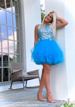 Pretty girl leaning against pillar in Fabulous Turquoise Beaded Short Homecoming Dress at Rsvp Prom and Pageant, Atlanta, Georgia