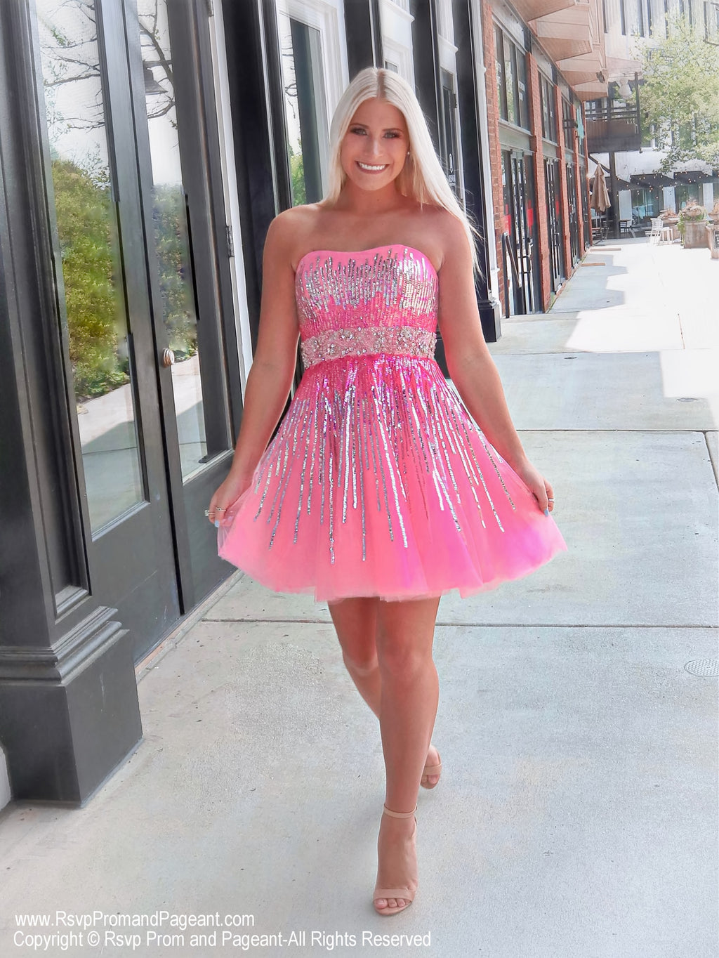Girl walking in Gorgeous Strapless Pink Sequins Homecoming Dress at Rsvp Prom and Pageant, best prom dress store in Atlanta, Georgia