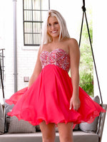 Beautiful girl in delicate Strapless Red Chiffon Short Homecoming Dress at Rsvp Prom and Pageant, best prom dress store, Atlanta, Georgia