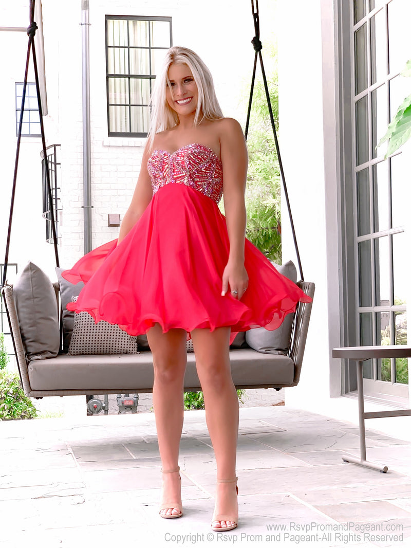 Girl twirling in delicate Strapless Red Chiffon Short Homecoming Dress at Rsvp Prom and Pageant, best prom dress store, Atlanta, Georgia
