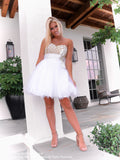 Sweet girl in Darling White Short Homecoming Dress with Gold Bodice and Bow at Rsvp Prom and Pageant, the best prom dress store in Atlanta, Georgia