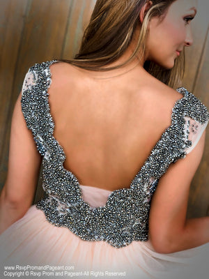 Closeup of back of model in a Fabulous Short Dress with Completely beaded Top and Full Tulle Skirt at Rsvp Prom and Pageant, the largest prom dress store in the Southeast USA located in metro Atlanta, Georgia