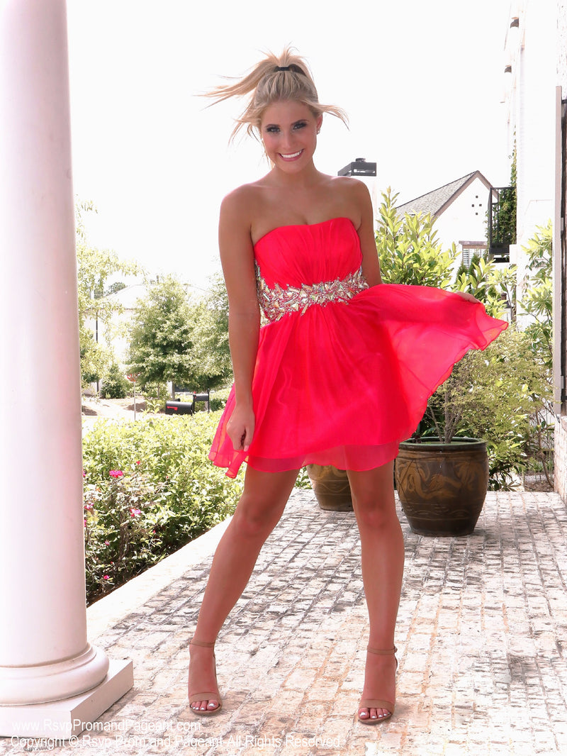 Blonde model in Adorable Little Dress Perfect for Homecoming at Rsvp Prom and Pageant, the best prom dress store located in metro Atlanta, GA and also known as Promheaven!