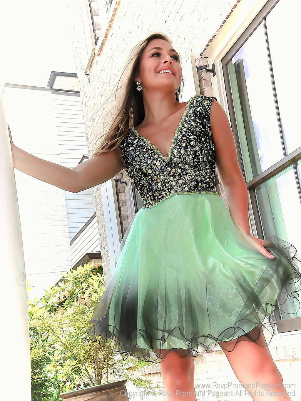 Model in Exclusive Ombre Mint into Black Short Dress with Irisdescent Bodice at Rsvp Prom and Pageant which is the largest prom brand locted in metro Atlanta, Georgia