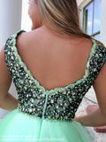 Back of Exclusive Ombre Mint into Black Short Dress with Irisdescent Bodice at Rsvp Prom and Pageant which is the largest prom brand locted in metro Atlanta, Georgia