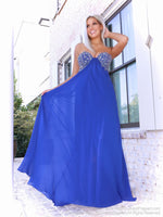 Model in a royal blue prom dress that's so pretty with a classic empire waist and beadwork in various hues of blue, and a delicate chiffon skirt. And it's at Rsvp Prom and Pageant, your source for the HOTTEST Prom and Pageant Dresses and Exclusive Evening Gowns and located in Atlanta, Georgia!