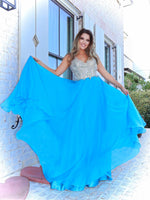 Model feeling like a true princess in this beautiful blue evening gown! The bodice is adorned with the most exquisite stone work leading to a light and flowing chiffon skirt. And it's at Rsvp Prom and Pageant, your source for the HOTTEST Prom and Pageant Dresses and exclusive evening gowns and located in Atlanta, Georgia!